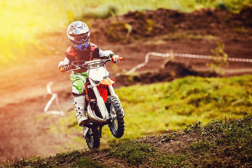Racer child on motorcycle participates